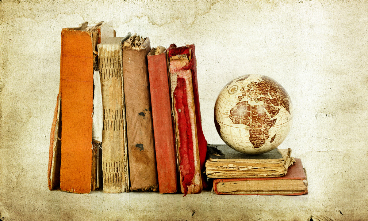 Old books and Earth globe